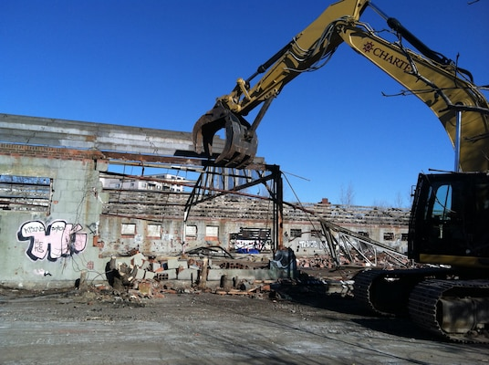 Buildings are demolished as part of the remedial action plan for the Watertown GSA Formerly Used Defense Site.