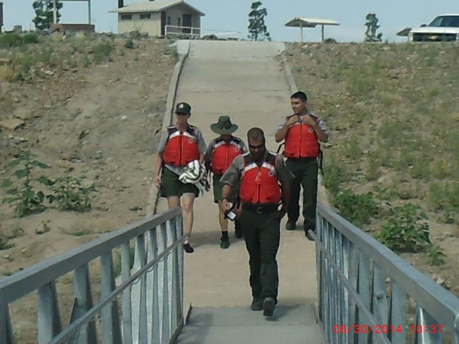"2014 District Photo Drive entry. Photo by Lauren Boyer, June 30, 2014.  ""Conchas Park Rangers descend to the boat ramp at the lake on their way to conduct water rescue training."""