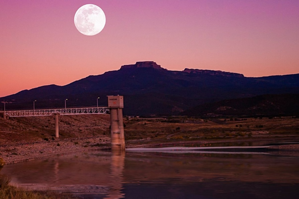 TRINIDAD LAKE, Colo., -- The moon rises as the sun sets at the lake in October 2014.  This photo placed 2nd in the District's annual photo drive based on employee voting. Photo by Joseph Torres.
