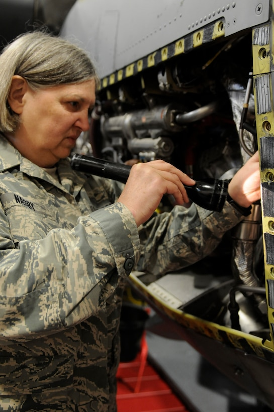 U.S. Air Force Tech. Sgt. Patricia Nasby, an aircraft mechanic in the 123rd Maintenance Squadron, examines the engine of a C-130 at the Kentucky Air National Guard Base in Louisville, Ky., Oct. 13, 2014. Nasby is the only full-time female mechanic in the shop and has been a member of the wing for 34 years. She plans to retire in February 2015. (U.S. Air National Guard photo by Staff Sgt. Vicky Spesard)