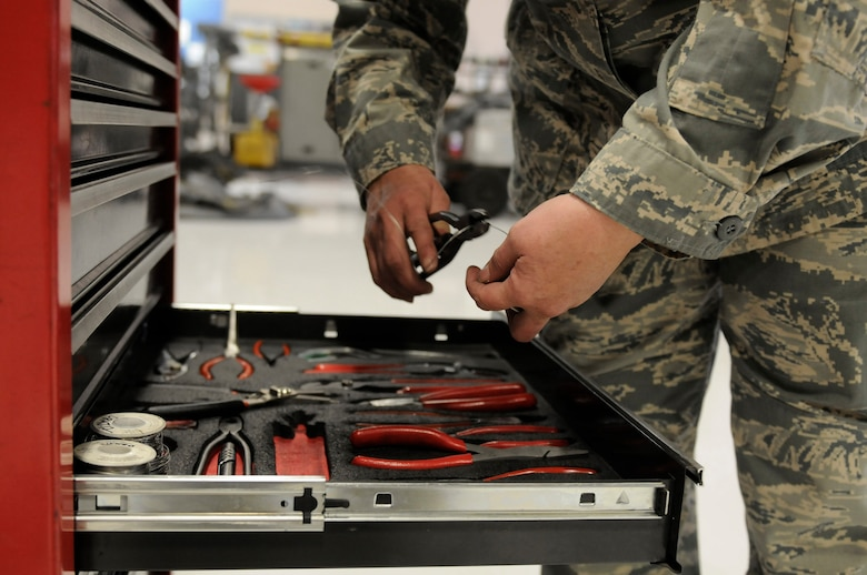 U.S. Air Force Tech. Sgt. Patricia Nasby, an aircraft mechanic in the 123rd Maintenance Squadron, prepares the tools she will need to repair a C-130 at the Kentucky Air National Guard Base in Louisville, Ky., Oct. 13, 2014. Nasby is the only full-time female mechanic in the shop and has been a member of the wing for 34 years. She plans to retire in February 2015. (U.S. Air National Guard photo by Staff Sgt. Vicky Spesard)