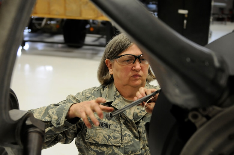 U.S. Air Force Tech. Sgt. Patricia Nasby, an aircraft mechanic in the 123rd Maintenance Squadron, works on the propeller of a C-130 at the Kentucky Air National Guard Base in Louisville, Ky., Oct. 13, 2014. Nasby is the only full-time female mechanic in the shop and has been a member of the wing for 34 years. She plans to retire in February 2015. (U.S. Air National Guard photo by Staff Sgt. Vicky Spesard)