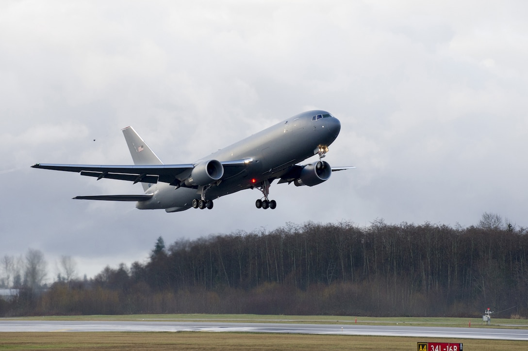 The KC-46 Pegasus development program completed its first flight of Engineering, Manufacturing and Development (EMD) aircraft #1 Dec. 28, 2014. The maiden flight took off at 9:29 AM PST from Paine Field in Everett, Washington, and landed at 1:01 PM PST at Boeing Field in Seattle.EMD #1 is a provisioned 767-2C freighter and the critical building block for the KC-46 missionized aerial refueler. (Courtesy photo)