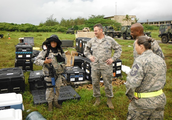 2nd Lt. Denisse Paz, 644th Combat Communications Squadron mission commander, briefs Brig. Gen. Andrew Toth, 36th Wing commander, and Chief Master Sgt. Michael McMillan, 36th Wing command chief, on the site and status of the personnel during an exercise Oct. 28, 2014, at Andersen South, Guam. The exercise allowed Airmen from the 644th CBCS to exercise their abilities to respond to various scenarios during contingency operations. (U.S. Air Force courtesy photo/Released)
