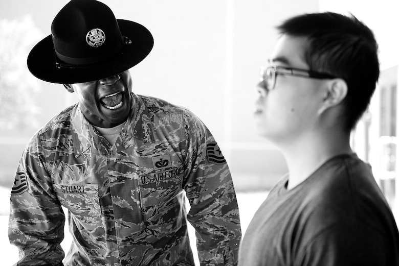 Tech. Sgt. Chananyah Stuart reminds a trainee of the procedures for entering the dining facility Sept. 26, 2014, at Joint Base San Antonio-Lackland, Texas. Stuart is extra demanding on his trainees from the very beginning because he believes it sets them up for success. Stuart is a 323rd training Squadron military training instructor. (U.S. Air Force photo/Master Sgt. Jeffrey Allen)