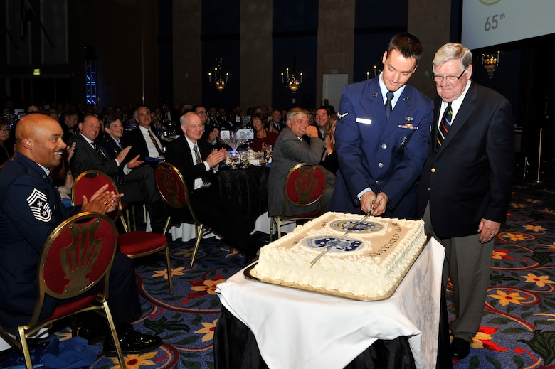 Major General Tim Padden (Ret.) and Airman Samuel Macklin, cut the ceremonial cake during a banquet hosted by the Space Foundation in honor of Air Force Space Command's 30th anniversary celebration Sept. 14, 2012, Colorado Springs, Colo.  General Padden was the third Commander of Air Force Space Command and Airman Macklin is from the 721st Security Forces Squadron, Cheyenne Mountain Air Force Station. (U.S. Air Force photo/Staff Sgt. Christopher Boitz/Released)