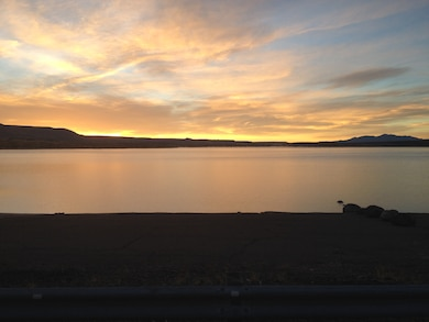 "2014 District Photo Drive entry. Photo by Michelle Gilo, Nov. 19, 2014. ""Watching the sunrise above the lake from the Cochiti Lake boat ramp."""