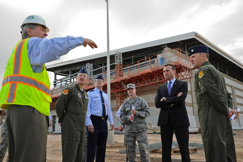 Undersecretary of the Air Force Eric Fanning is briefed by Craig Killmer during a tour of the Academic Training Center construction site on March 14, 2014, at Luke Air Force Base, Ariz. The 145,000 square-foot facility will include pilot academic training classrooms, 12 F-35 simulators, a secured briefing auditorium, and space for administrative, instructor and engineering personnel. Killmer is the Archer Western Contractors project manager. (U.S. Air Force photo/Staff Sgt. Darlene Seltmann)