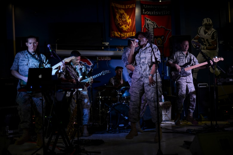U.S. Air Force Central Command's band, Hypersonic, performs for members of the 386th Air Expeditionary Wing May 3, 2014, in Southwest Asia. The band spent four days touring the region, performing for deployed troops to boost morale and reaching out to host nation communities. The band is deployed from Yokota Air Base, Japan. (U.S. Air Force photo/Staff Sgt. Jeremy Bowcock)