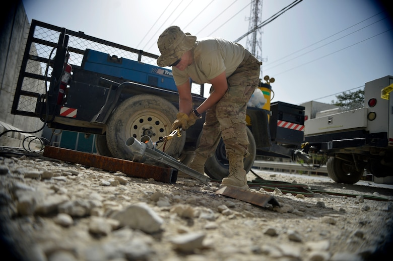 Staff Sgt. Samantha Orem welds parts for a fence Sept. 19, 2014, at Bagram Airfield, Afghanistan.  Airmen with the 455th Expeditionary Civil Engineer Squadron are completing a security fence project.  Orem is a 455th ECES structures craftsman. (U.S. Air Force photo/Staff Sgt. Evelyn Chavez)
