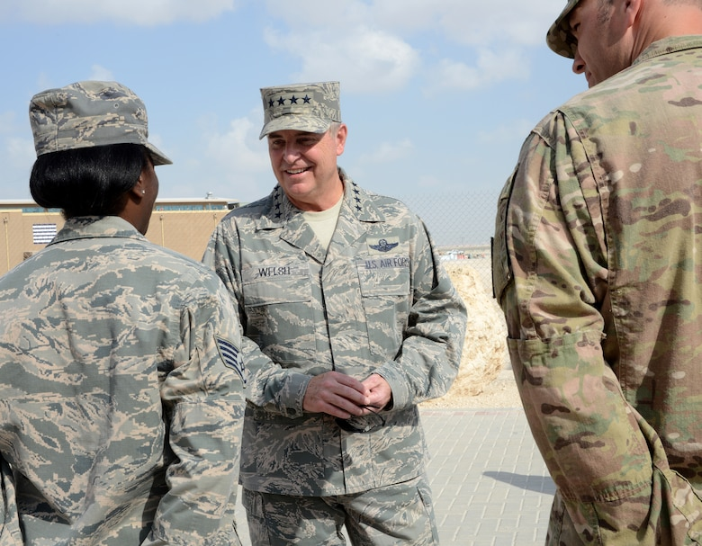 Air Force Chief of Staff Gen. Mark A. Welsh III speaks with Airmen during a base visit, Dec. 14, 2014, at Al Udeid Air Base, Qatar. Welsh met with Airmen to thank them for their service and discuss the sacrifices and challenges experienced while deployed. (U.S. Air Force photo/Senior Airman Kia Atkins)