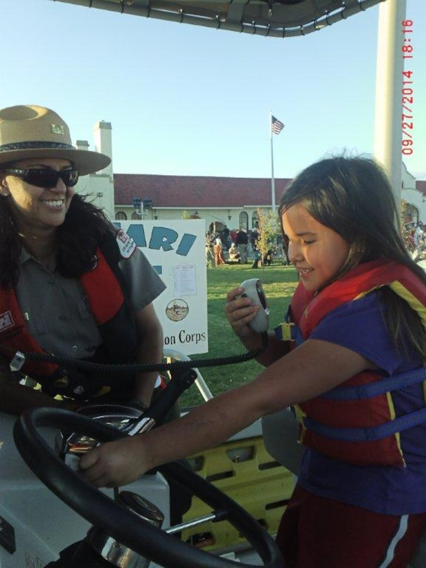 """2014 District Photo Drive entry. Photo by Valerie Mavis, Sept. 27, 2014. """"Seasonal Park Ranger Nadine Carter helps educate the public during a community event in Tucumcari N.M."""""""