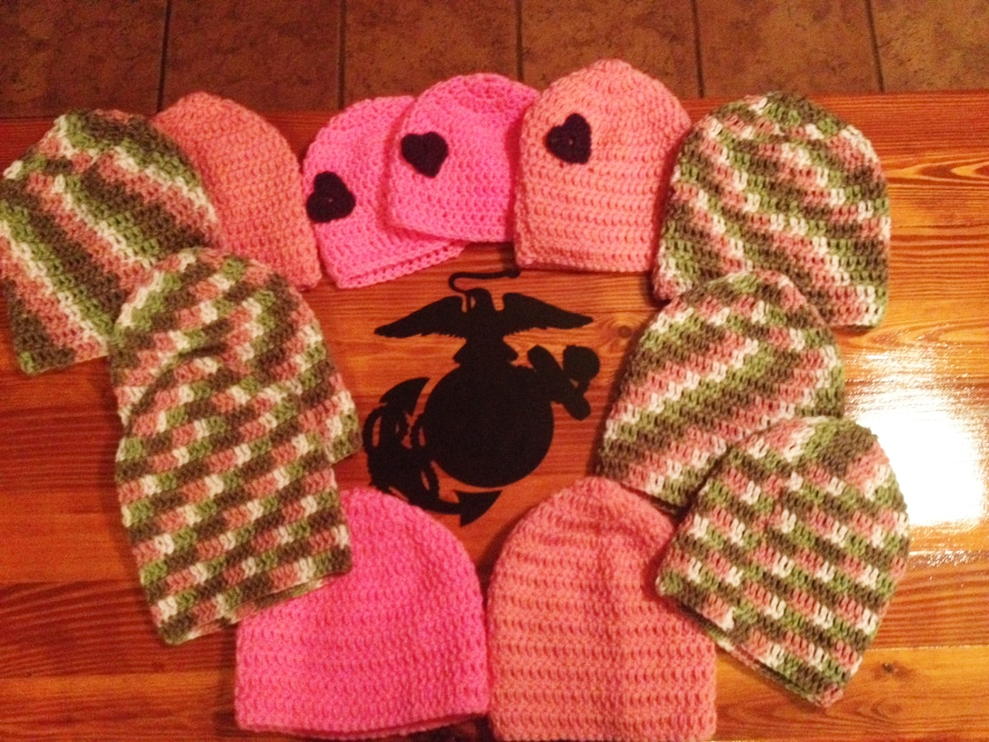 "The Kirschners crocheted pink beanies for Breast Cancer Awareness Month, and small child-sized hats with purple hearts for their ""Hearts of Valor"" program, to benefit the children at the VFW National Home for Children in Eaton Rapids, Michigan."