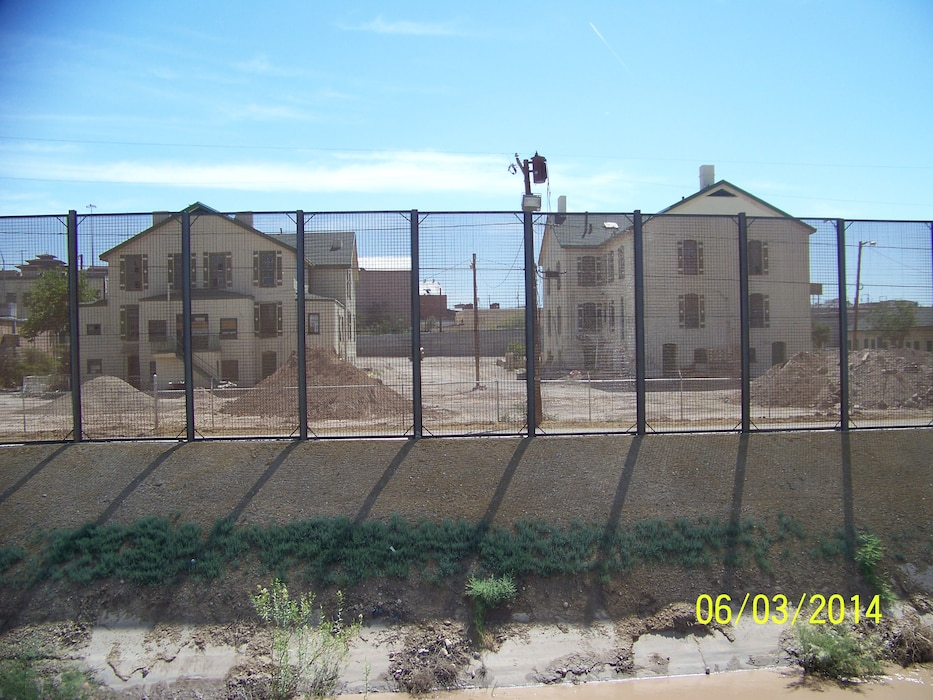 "2014 District Photo Drive entry. Photo by Art Aranda, June 3, 2014.  ""The Border Fence with the historic Old Ft. Bliss Officers' Quarters in the background."""
