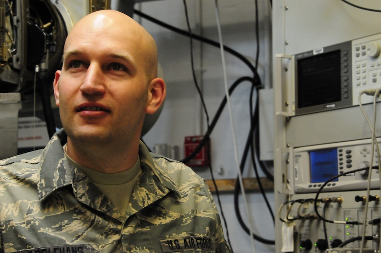 Tech Sgt. Matthew Applehans, Electronic Warfare Systems Craftsman, 140th Maintenance Group, discusses the intricacies of the electronic counter measure pod. (U.S. Air National Guard Photo by Staff Sgt. Nicole Manzanares)