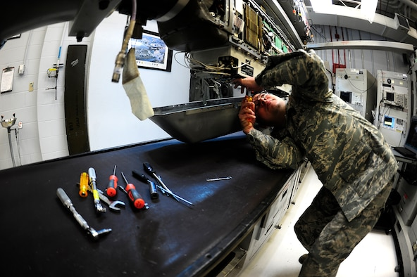 Staff Sgt. Robert Yeverino, 140th Maintenance Group, Electronic Warfare Systems Craftsman, performs a quality assurance inspection; double checking connections to ensure an efficient electronic counter measure pod. (U.S. Air National Guard Photo by Staff Sgt. Nicole Manzanares)