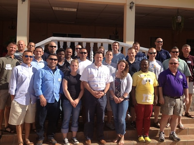 """Members of Joint Task Force-Bravo pose for a photo during a marriage retreat at the Comayagua Golf Club, Honduras, Jan. 30, 2014. Twenty-six members of the Task Force attended the event, which was coordinated by the Joint Task Force-Bravo Chaplain's Office. The theme of the retreat was """"Finding Strength for Military Marriages,"""" and topics discussed included communication, marriage pitfalls, and reintegration.  (Courtesy photo)"""