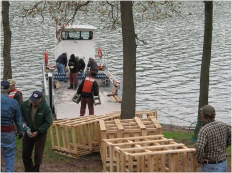 Corps members and volunteers prepare artificial structures for fisheries management.