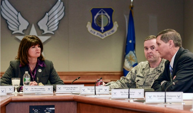 Dr. Mica Endsley speaks with Col. Greg Barnhart and Garry Gagnon during an open discussion Jan. 23, 2014 at Hanscom Air Force Base, Mass. During her visit to the base, Endsley received program briefings at Hanscom AFB and MIT Lincoln Laboratory, learned about development planning work and visited STARBASE, a DOD-initiative to get youth interested in science, technology. Endsley is the chief scientist for the Air Force, Barnhart is Hanscom AFB's deputy associate director for Engineering and Gagnon is the Battle Management engineering director. (U.S. Air Force photo/Walter Santos)