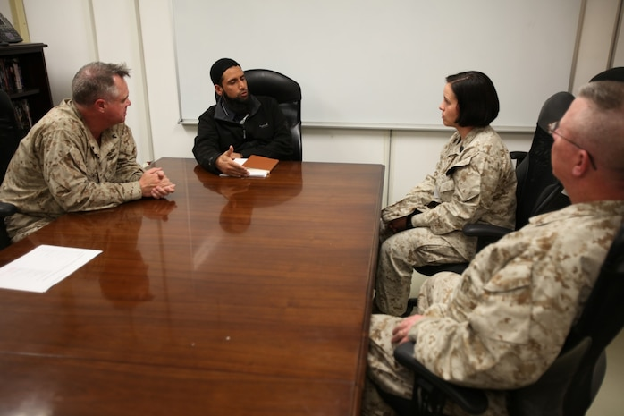 Imam Asim Hafiz, center left, an Islamic religious advisor with the British Ministry of Defence, talks to Master Sgt. Anetra Cargile, center right, spectrum management officer, Regional Command (Southwest), and a Pasadena, Texas, native. Commander Patrick Smith, left, RC(SW) chaplain, and Cmdr. Thomas Hunt, right, I Marine Expeditionary Force (Forward) chaplain, brought Muslim Marines to meet Imam Hafiz aboard Camp Leatherneck, Afghanistan, Jan. 26, 2014.