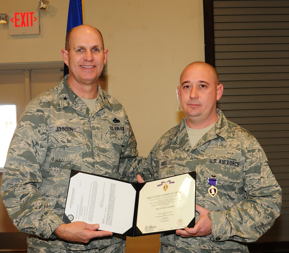 Tech. Sgt. Shawn Hisel awarded Purple Heart for wounds sustained on deployment. Brig. Gen. Johnson, Assistant Adjutant General, Air, presented the award. (U.S. Air Force photo by Staff Sgt. Darrell Hamm/Released)