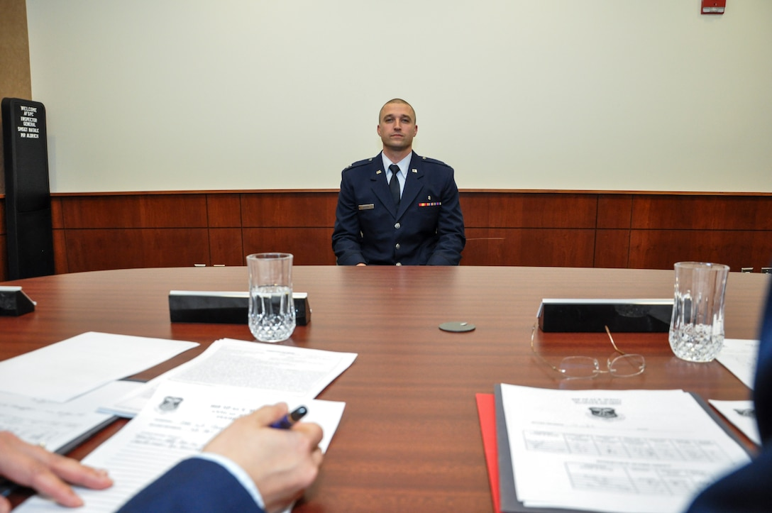 Capt. John Doleski, 460th Medical Group company grade officer category annual award nominee, sits before a mock annual awards board panel Jan. 27, 2014, at the 460th Space Wing headquarters building on Buckley Air Force Base, Colo. All competitors met the annual awards board as part of their overall submission packages. (U.S. Air Force photo by Staff Sgt. Nicholas Rau/Released)
