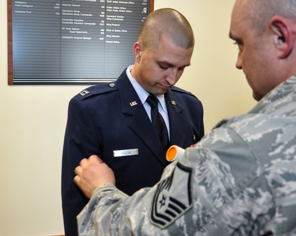 Master Sgt. Jody Brown, 460th Medical Group, right, helps prepare Capt. John Doleski, 460th MDG company grade officer category annual award nominee, uniform before meeting the annual award board Jan. 27, 2014, at the 460th Space Wing headquarters building on Buckley Air Force Base, Colo. All competitors met the annual awards board as part of their overall submission packages. (U.S. Air Force photo by Staff Sgt. Nicholas Rau/Released)