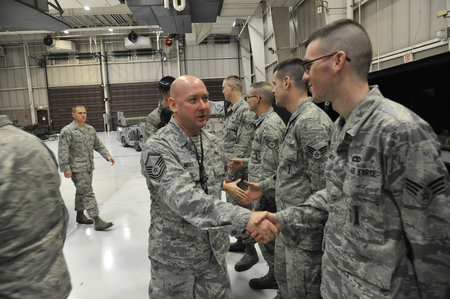509th Maintenance Group/ 393rd Aircraft Maintenance Unit crew 3 completes all requirements during the 2013 Weapons Load Crew Competition of the Year at Whiteman Air Force Base, Mo., Jan. 24, 2014. The crew is greeted with congrats for successfully completing all requirements during the competition. (U.S. Air Force photo by Airman 1st Class Keenan Berry/Released)