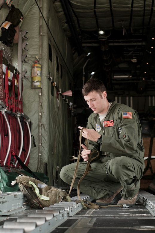 U.S. Air Force Senior Airman Nick J. Barth, an aircraft loadmaster with the 169th Airlift Squadron, packs a training bundle on a C-130 Hercules at Alpena, Mich., in support of Exercise Northern Strike 2013 on Aug. 7, 2013. Exercise Northern Strike 2013 is a joint multi-national combined arms training exercise conducted in northern Michigan. (U.S. Air National Guard photo by Master Sgt. Scott Thompson/released)