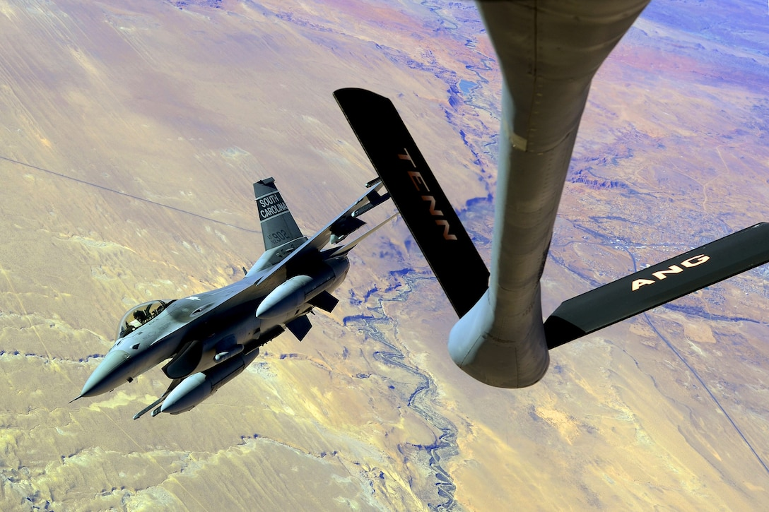 Pictorial Photograph, 2nd Place  U.S. Air Force Col. Scott Lambe, a fighter pilot with the South Carolina Air National Guard's Joint Forces Headquarters, receives fuel from a KC-135R Stratotanker from the 134th Air Refueling Wing, Tennessee Air National Guard, while flying an F-16 Fighting Falcon fighter jet, Nov. 12, 2013. Col. Lambe is flying the F-16 fighter jet back to S.C. from a temporary duty at Nellis Air Force Base, Nev., where the unit deployed to accomplish training for an upcoming Aerospace Expeditionary Force deployment.  (U.S. Air National Guard photo by Tech. Sgt. Caycee Watson/Released)