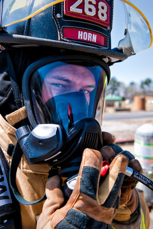 Portrait-Personality Photograph, 3rd Place  U.S. Army Spc. Matthew Horn, a firefighter with the 268th Engineer Detachment, South Carolina National Guard attaches the regulator/breathing tube to his mask at the South Carolina Fire Academy in Columbia, S.C., March 29, 2013. Firefighters of the 264th, 265th, 266th, 267th and 268th Engineer Detachments are performing their two-week annual training at the academy as part of their unit validation. (U.S. Air National Guard photo by Tech. Sgt. Jorge Intriago/Released)