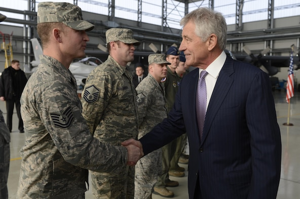 Tech. Sgt. Brian Williams receives a handshake from Secretary of Defense Chuck Hagel Jan. 31, 2014, at Powidz Air Base, Poland. The Aviation Detachment's mission supports Poland's continued defense modernization and standardization with the U.S. and the North Atlantic Treaty Organization. Williams is the 52nd Operations Group Aviation detatchment NCO in charge of client systems  (U.S. Air Force photo/Staff Sgt. Christopher Ruano)
