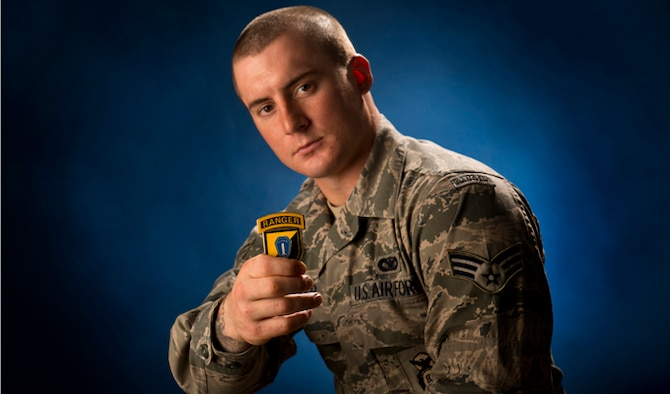 Senior Airman Stephen Becker holds a commander's coin from the U.S. Army Ranger School Jan. 31, 2014, at Joint Base Elmendorf-Richardson, Alaska. Becker is the 257th Airman to graduate from the U.S. Army Ranger School at Ft. Benning, Ga. The purpose of the school is to develop combat skills of selected officers and enlisted men by requiring them to perform effectively as small unit leaders in a realistic tactical environment, under mental and physical stress approaching that found in actual combat. (U.S. Air Force photo/Justin Connaher)