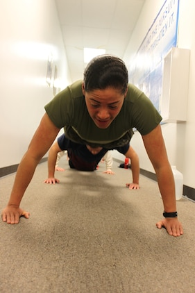 U.S. Marine Corps Pvt. Nisa Jovel leads squad push-ups during pool physical fitness indoors during inclement weather in Frederick, Md., Jan. 30, 2014. Jovel is on 10-day boot leave and is getting her first taste of leading Marines by volunteering her time with Recruiting Sub-station Frederick. (U.S. Marine Corps photo by Sgt. Amber Williams/Released)