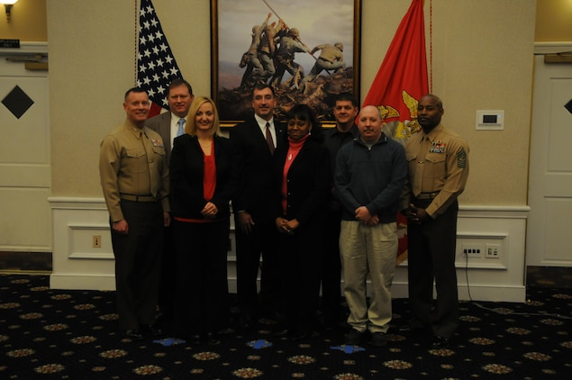 Col. David Maxwell, commander of Marine Corps Base Quantico, left, and Sgt. Maj. Mark Byrd, base sergeant major, right, pose with the 2013 civilians of the year and civilians of the fourth quarter during their award ceremony at The Clubs at Quantico on Jan. 29, 2014. They are, from left, David Newman, head of the Civilian Manpower Branch; Rebecca Childress, prevention and education specialist for Marine Corps Community Services; Michael Smith, deputy command inspector general; Jacqueline Tyson, customer service clerk with the Public Works Branch; Firefighter James Thacker with the base Fire and Emergency Services; and Assistant Chief Tracy Wheeler, assistant chief of operations for Fire and Emergency Services.