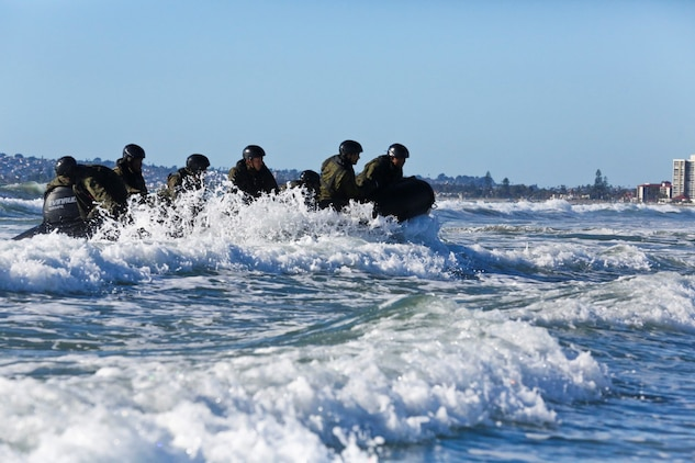 Soldiers with the Japan Ground Self-Defense Force conduct surf passages on a Combat Rubber Reconnaissance Craft as part of reconnaissance training with the Expeditionary Warfare Training Group Pacific during Exercise Iron Fist 2014 aboard Naval Amphibious Base Coronado, Calif., Feb. 3, 2014. Iron Fist is an amphibious exercise that brings together Marines and sailors from the 15th Marine Expeditionary Unit, other I Marine Expeditionary Force units, and soldiers from the JGSDF, to promote military interoperability and hone individual and small-unit skills through challenging, complex and realistic training. (U.S. Marine Corps photo by Lance Cpl. Ricardo Hurtado/Released)