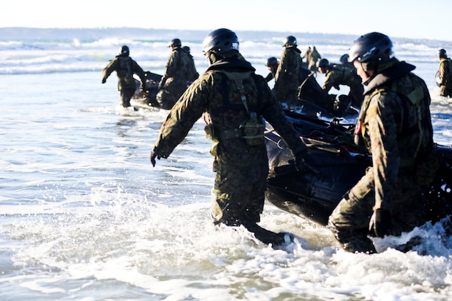 Soldiers with the Japan Ground Self-Defense Force prepare to board a Combat Rubber Reconnaissance Craft to conduct an amphibious raid as part of reconnaissance training with the Expeditionary Warfare Training Group Pacific during Exercise Iron Fist 2014 aboard Naval Amphibious Base Coronado, Calif., Feb. 3, 2014. Iron Fist is an amphibious exercise that brings together Marines and sailors from the 15th Marine Expeditionary Unit, other I Marine Expeditionary Force units, and soldiers from the JGSDF, to promote military interoperability and hone individual and small-unit skills through challenging, complex and realistic training. (U.S. Marine Corps photo by Lance Cpl. Ricardo Hurtado/Released)