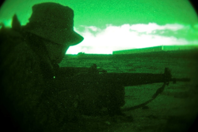 A soldier with the Japan Ground Self-Defense Force posts security while conducting an amphibious raid as part of reconnaissance training with the Expeditionary Warfare Training Group Pacific during Exercise Iron Fist 2014 aboard Naval Amphibious Base Coronado, Calif., Feb. 3, 2014. Iron Fist is an amphibious exercise that brings together Marines and sailors from the 15th Marine Expeditionary Unit, other I Marine Expeditionary Force units, and soldiers from the JGSDF, to promote military interoperability and hone individual and small-unit skills through challenging, complex and realistic training. (U.S. Marine Corps photo by Lance Cpl. Ricardo Hurtado/Released)