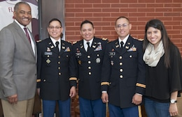 Washington State University President Elson S. Floyd, Capt. Jack Claros, Capt. Joseph Claros, Capt. Donald Claros (now Maj.) and sister Bella Claros. Capt. Joseph Claros is one of three identical brothers and an engineering/logistics officer at the U.S. Army Corps of Engineers Far East District Pyeongtaek Resident Office.