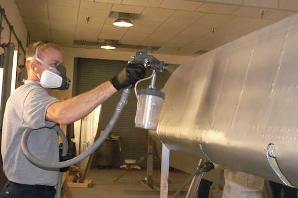 DAYTON, Ohio -- National Museum of the U.S. Air Force restoration specialist Brian Lindamood applies aluminized cellulose nitrate dope to a the Stearman PT-13D Kaydet. This paint serves as a UV protectant which keeps the fabric from deteriorating. Plans call for the aircraft to be part of an expanded Tuskegee Airman exhibit in the World War II Gallery at the National Museum of the U.S. Air Force. (U.S. Air Force photo by Ken LaRock)