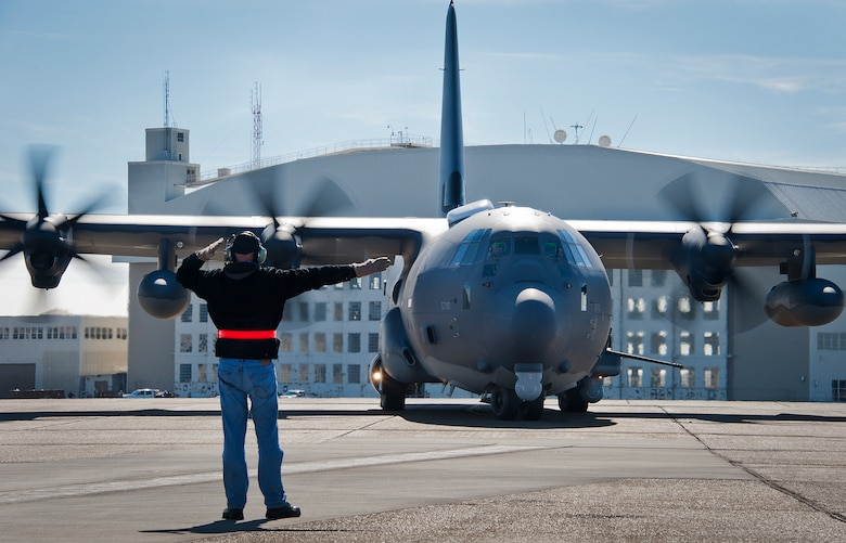 Dave King, of Lockheed Martin, marshals out the AC-130J Ghostrider as it taxis the runway for its first official sortie Jan. 31 at Eglin Air Force Base, Fla. The Air Force Special Operations Command MC-130J arrived at Eglin in January 2013 to begin the modification process for the AC-130J, whose primary mission is close air support, air interdiction and armed reconnaissance. A total of 32 MC-130J prototypes will be modified as part of a $2.4 billion AC-130J program to grow the future fleet. (U.S. Air Force photo/Chrissy Cuttita)