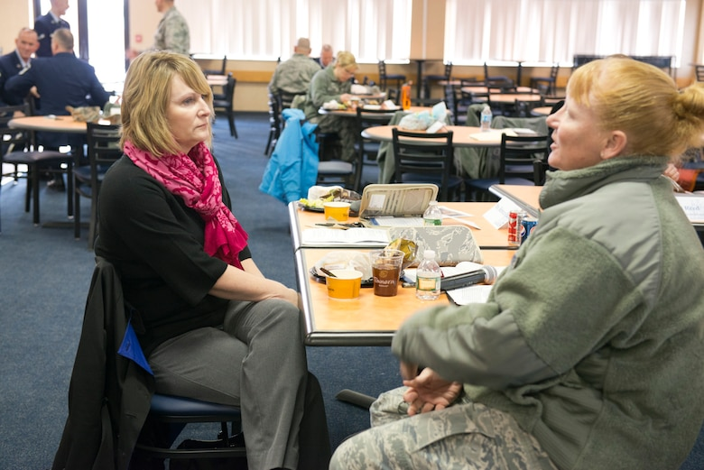Marie Hotaling,left, wife of Chief Master Sgt. James Hotaling, Command Chief of the Air National Guard discusses childcare services for unit members with Master Sgt. Donna Sliger during a visit to the 167th Airlift Wing Jan. 31. The trip was geared toward identifying challenges facing Airmen and their families. (Air National Guard photo by Master Sgt. Emily Beightol-Deyerle)