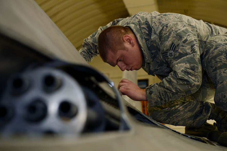U.S. Air Force Senior Airman David Gondek, 52nd Aircraft Maintenance Squadron weapons technician, inspects an F-16 Fighting Falcon weapons system on Spangdahlem Air Base, Jan. 28, 2014. The Aircraft is fitted with one 20 millimeter multi-barrel cannon with 500 rounds. (U.S. Air Force photo by Staff Sgt. Christopher Ruano)