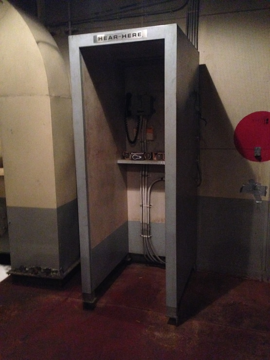 This sound proof phone booth aboard the STURGIS, a former nuclear reactor barge, allowed crew members to communicate with each other more than 30 years ago.
