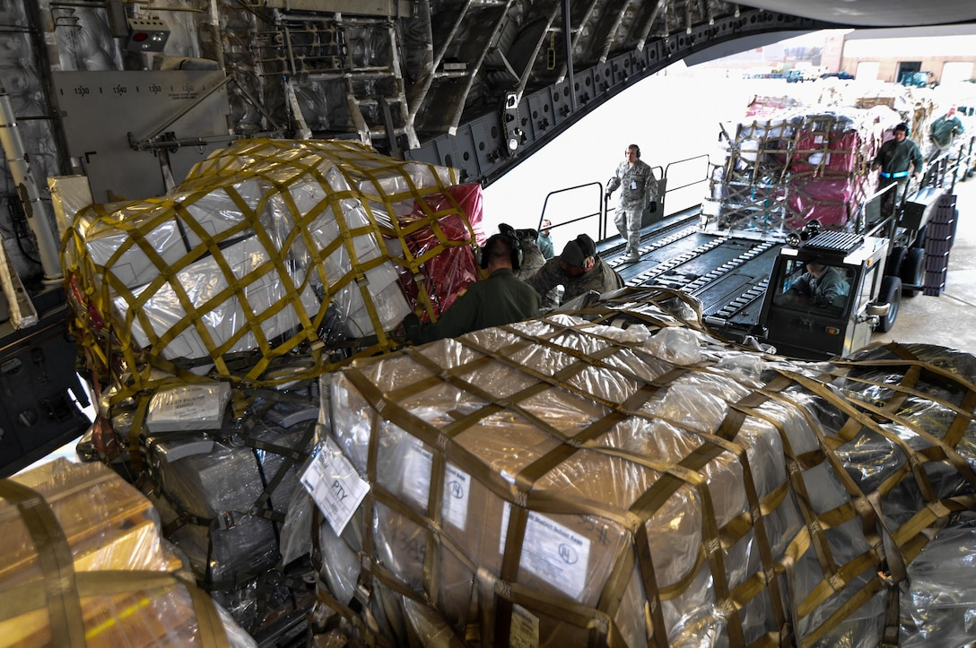 Reservists from the 701st Airlift Squadron load humanitarian aid onto a C-17 Globemaster III at Joint Base Charleston, S.C. The donated aid was delivered to Haiti, Panama and Honduras. (U.S. Air Force Photo/Maj. Wayne Capps)
