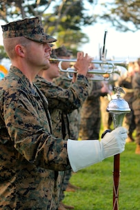 The Marine Corps Forces Pacific Band performs a Morning Colors Ceremony at Camp Smith, Hawaii with Headquarters and Service Battalion. The band also observed the promotion of one of their own, Staff Sergeant Matthew Duncan.