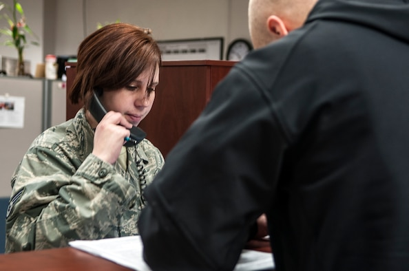 Staff Sgt. Vickie Erickson, 366th Comptroller Squadron financial management NCO, assists a customer with pay changes, as she verifies accuracy with the Defense Finance and Accounting Service at Mountain Home Air Force Base, Idaho, Feb. 5, 2014. Meticulous attention to detail and accuracy defines the 366th CPTS mission ethics and Erickson said their entire unit is motivated, mission focused and strives for 100 percent perfection in their duties. (U.S. Air Force photo by Master Sgt. Kevin Wallace/RELEASED)