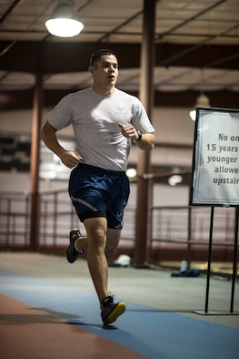 Senior Airman William Tibbetts, 366th Comptroller Squadron financial analyst and unit physical training leader, jogs during a 366th CPTS PT session at Mountain Home Air Force Base, Idaho, Jan. 24, 2014. Having deployed and gone on outside-the-wire missions, Tibbetts knows firsthand how important fitness is to being a ready Airman, so he balances it with other aspects of readiness and encourages others to do the same. (U.S. Air Force photo by Tech. Sgt. Samuel Morse/RELEASED)