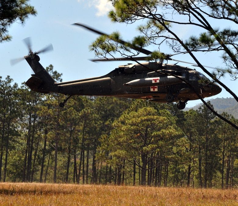 A UH-60 Blackhawk lifts off while carrying a simulated injured aircrew member during a personnel and downed aircraft recovery exercise in Honduras, Feb. 4, 2014.  The purpose of the exercise was to validate the unit's ability to immediately support a personnel recovery in the event of a downed aircraft. (U.S. Air Force photo by Capt. Zach Anderson)