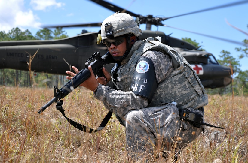 U.S. Army Staff Sgt. Hector Caraballo, Joint Security Forces Squadron, provides security during a medical evacuation of a simulated injured aircrew member during a personnel and downed aircraft recovery exercise in Honduras, Feb. 4, 2014.  The purpose of the exercise was to validate the unit's ability to immediately support a personnel recovery in the event of a downed aircraft. (U.S. Air Force photo by Capt. Zach Anderson)
